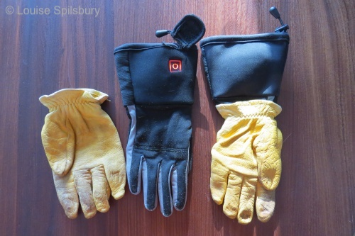Cold Snap: photo of electric gloves with red-lit button showing high setting. I wear deerskin gloves over top when I'm riding.