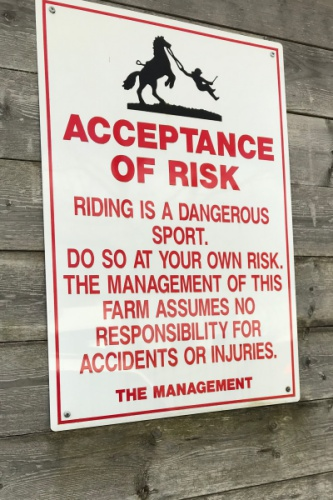 Fraidy-Cat Rider: 'Acceptance of Risk' sign at the barn
